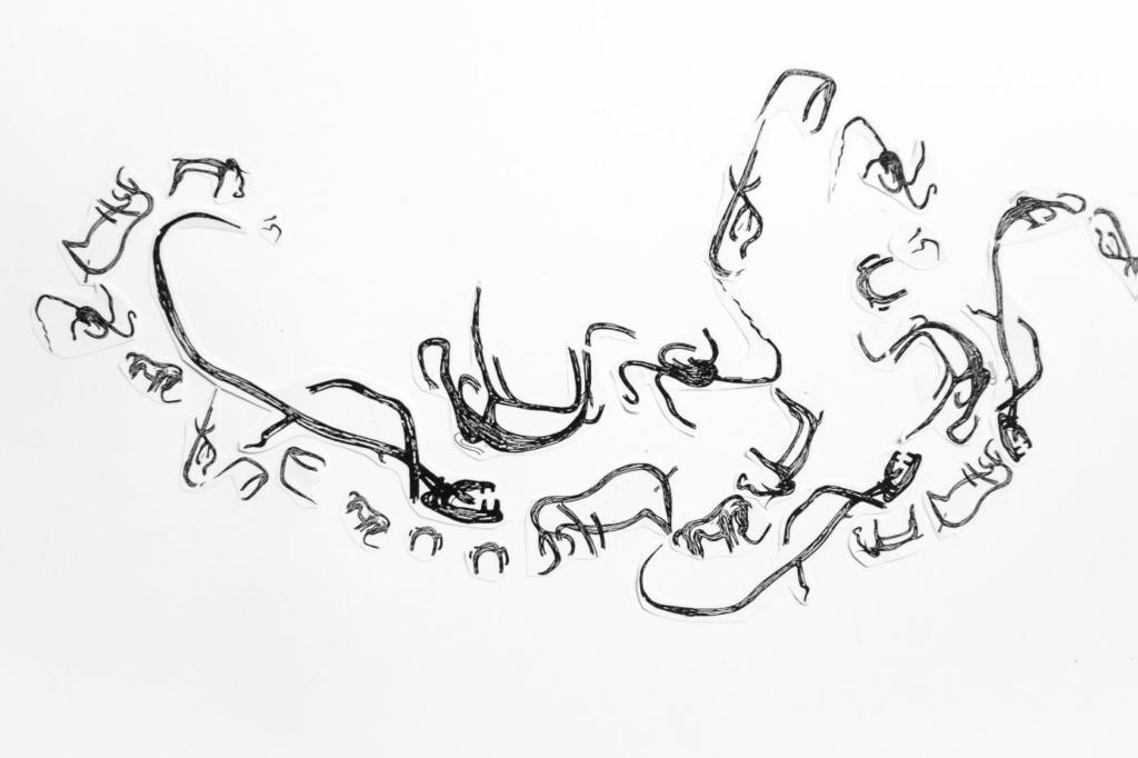 création de Géoglyphes en pierre arrangée représentant les fresques de la Baume Latrone